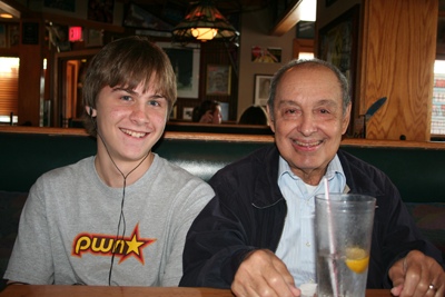 Joey with paternal grandfather at restaurant